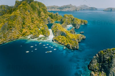 Palawan, Philippines aerial view of tropical Miniloc island. Tourism trip boats at big lagoon