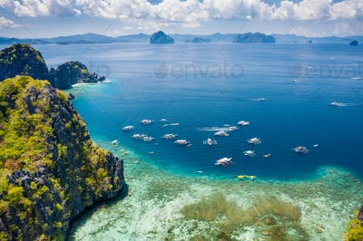 Miniloc island, Palawan, Philippines. Aerial view of tourism day trip boats on island hopping tour