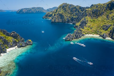 Aerial drone view of strait between Miniloc and Shimizu tropical islands. El Nido, Palawan