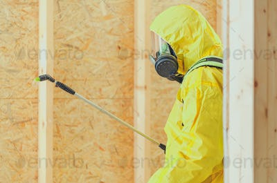 Worker in Safe Breathing Mask Disinfection Building Interior