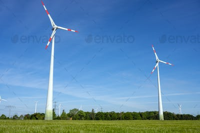 Modern wind turbines with a clear blue sky