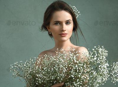 Woman beautiful old fashion portrait romantic female vintage. Gypsophila flowers.