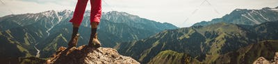 Successful hiker enjoy the view on high altitude mountain top