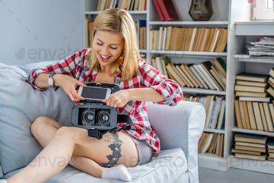 Female using virtual reality glasses device.