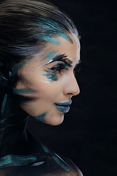 Side view portrait of a woman with make up.