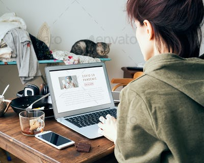 Digital addiction, woman in reads or writes articles about coronavirus on Internet