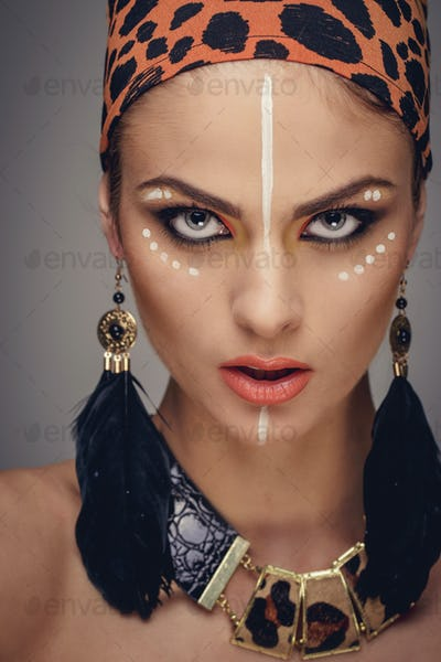 Portrait of woman with exotic make up.