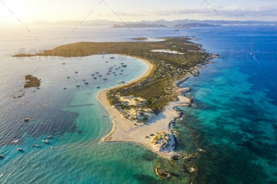 Aerial view over the clear beach and turquoise water of Formentera, Ibiza