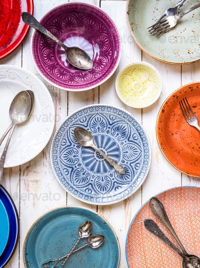 Set of different empty plates