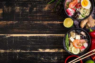 Table served with asian noodle soup background