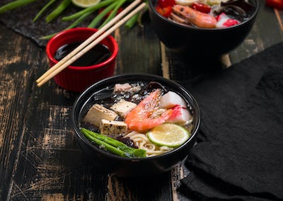 Table served with asian noodle soup