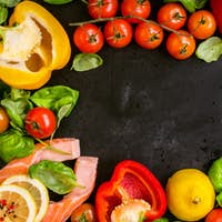 Raw salmon steaks and fresh ingredients for cooking frame