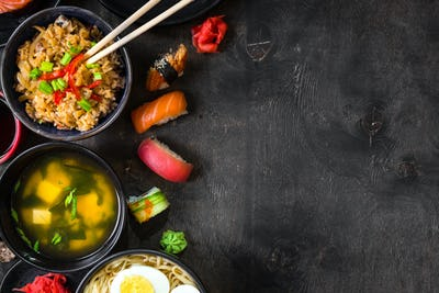 Sushi and japanese food on dark background