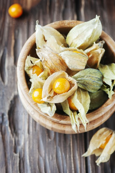 Yellow gooseberry on the wooden table
