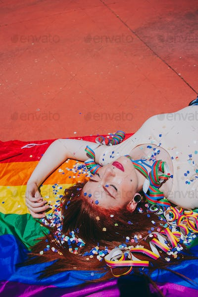 Young redhead woman celebrating gay pride day