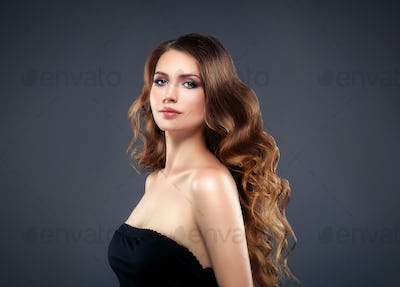 Beautiful hair woman beauty skin portrait over dark background. Long beautiful healthy hair mode