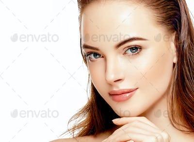 Beautiful woman with wet hair closeup face