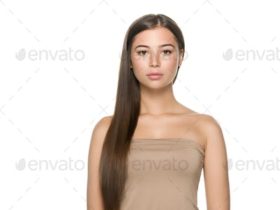 Beautiful freckles brunette woman with long smooth hair shine and soft isolated on white