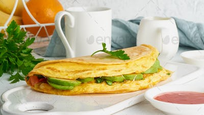 Trendy breakfast with quesadilla and eggs, trending food with omelet, cheese