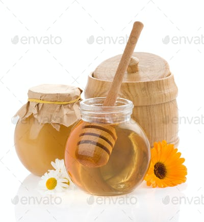 honey and flowers isolated on white