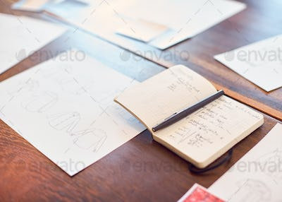 Drawings And Swatches Laid Out On Table For Creative Team Meeting