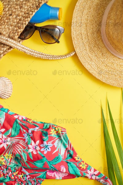 Female beach summer clothes and accessories collage on yellow background