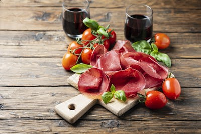 Italian antipasto with bresaola and red wine
