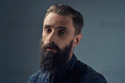 Close up portrait of sad bearded male.