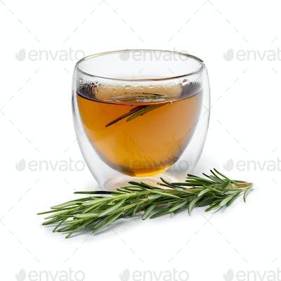 Fresh rosemary tea and fresh twig