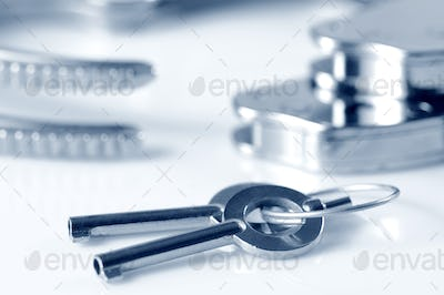Close-up of metal keys to handcuffs isolated over white background