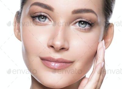 Clean skin grey eyes woman face macro