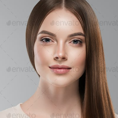 Smooth long brunette hair woman face close up