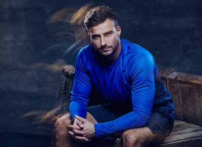 A man in blue sports jersey.