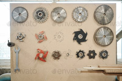 Square toolboard with metallic wrench, group of details for electric circle saw