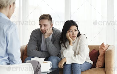 Unhappy Spouses After Family Conflict Sitting In Psychotherapist's Office
