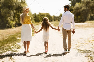 Family Walking Holding Hands Outdoor Spending Vacation In Country
