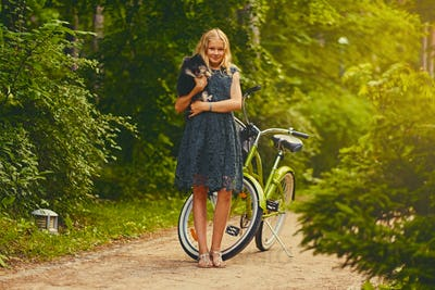 A girl holds Spitz dog.
