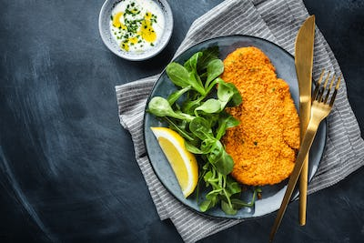 German schnitzel with vegetables on plate