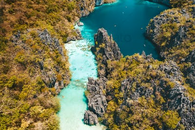 El Nido, Palawan, Philippines, aerial view of beautiful big lagoon, limestone cliffs and kayaking