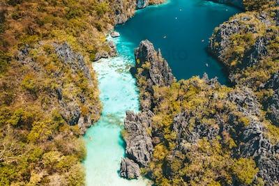El Nido, Palawan, Philippines, aerial view of beautiful big lagoon, limestone cliffs and kayaking