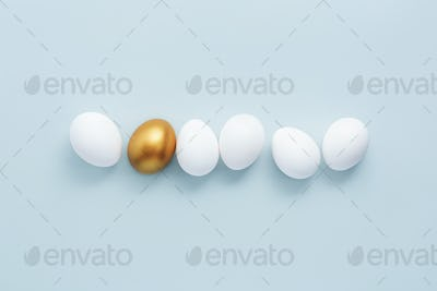 Golden egg with white eggs on pastel background