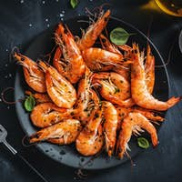 Fried shrimps with spices on plate