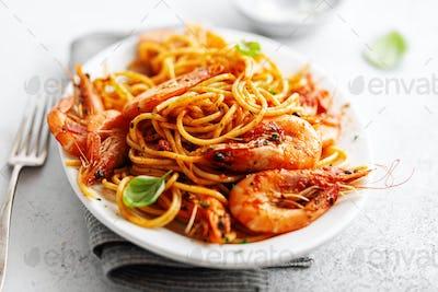 Pasta spaghetti with tomato sauce and shrimps