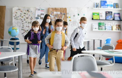 Group of children with face mask back at school after covid-19 quarantine and lockdown