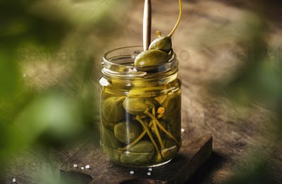 Capers. Marinated or pickled canned capers fruit in glass jar