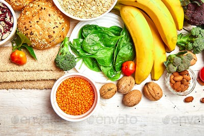 Selection food rich in fiber on white wooden background.
