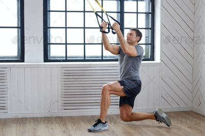 A man exercising with expanders.