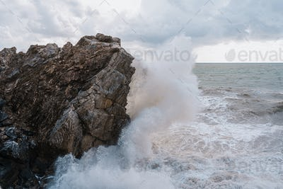 A shot of the rocks on the body of the foamy sea