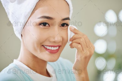 Woman wiping off make-up