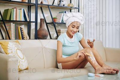 Woman applying hair removal cream